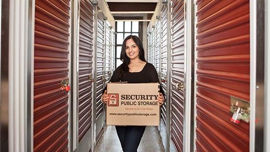 Woman holding a box at San Francisco self storage